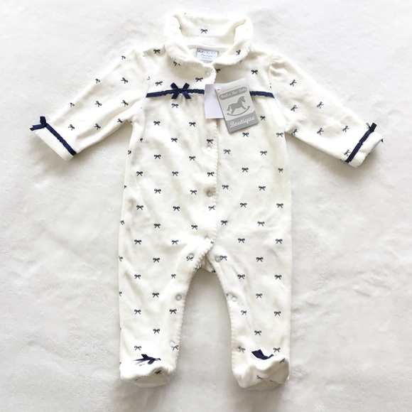 Soft velour footed onesie with bows